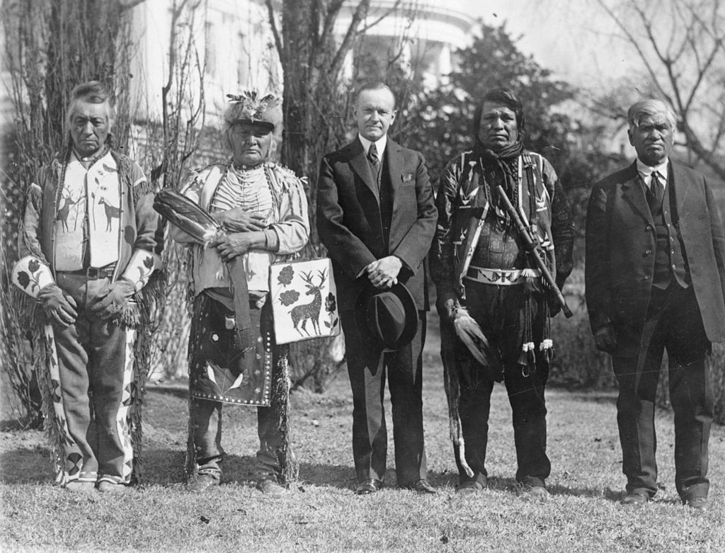 Four members of the Osage Nation with US President Calvin Coolidge in 1924.