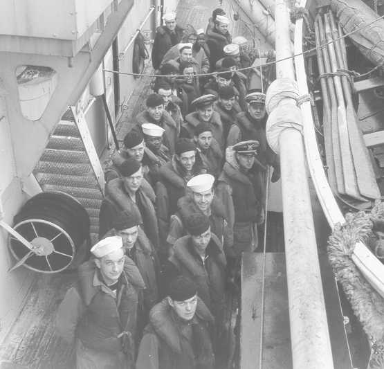 The U.S. Coast Guard Escanaba crew on board the boat in World War Two.