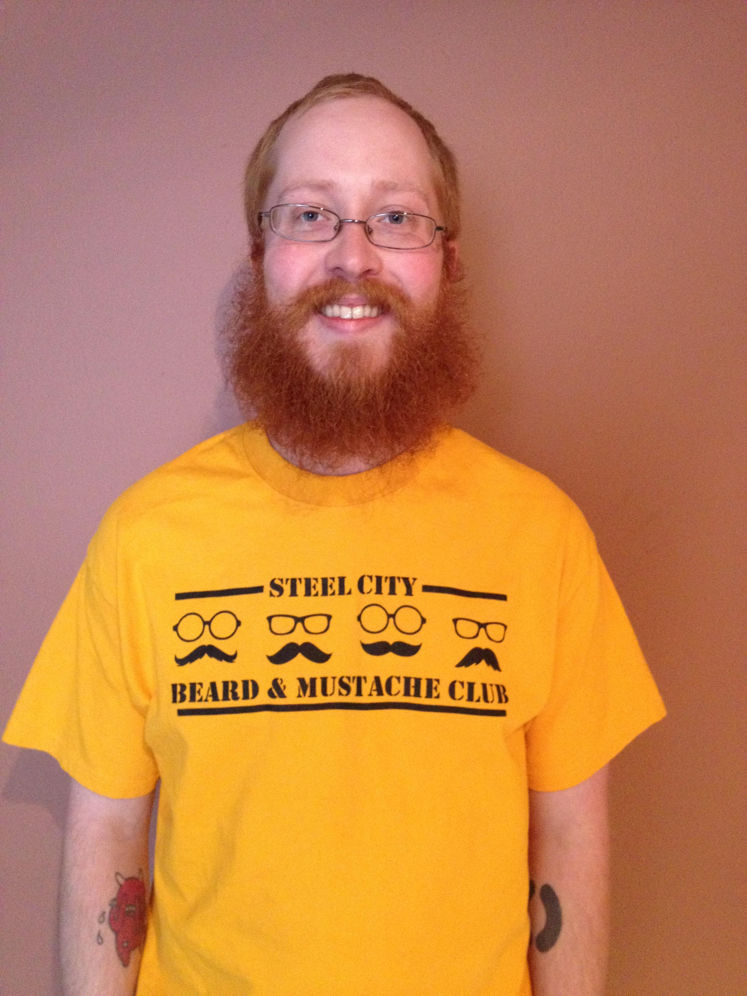 The champion displays his impressive winning beard and mustache.