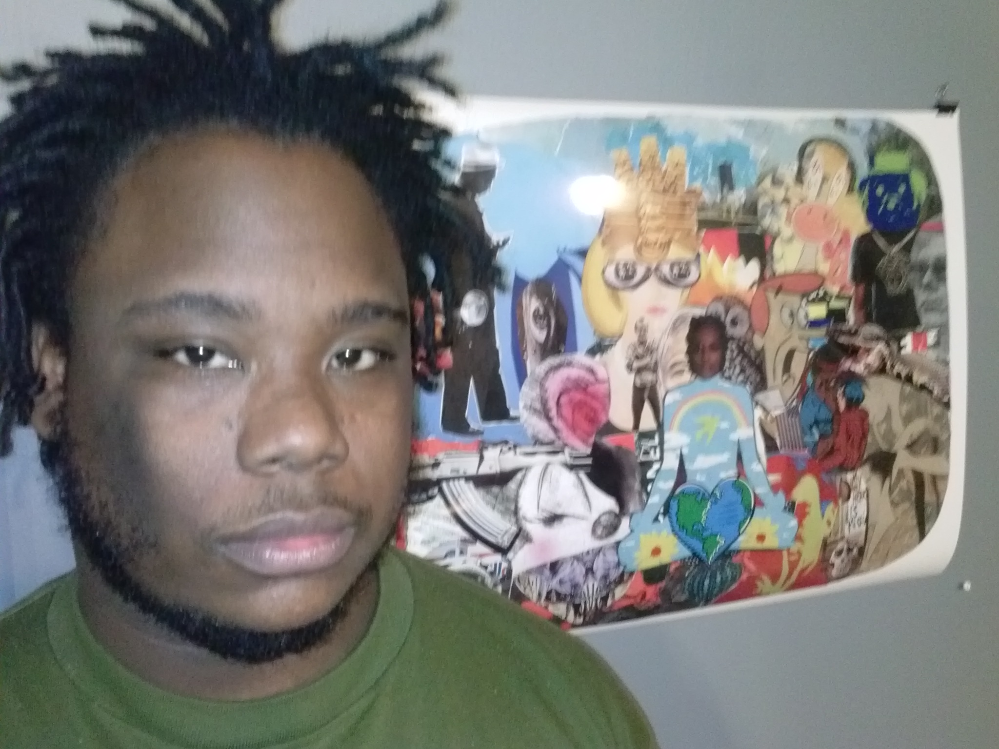 Grits Capone in front of a collage he created for  Art on the Walls , a show curated by DS Kinsel and currently up in the Greater Pittsburgh Arts Council offices in Downtown Pittsburgh. Photo provided by Grits Capone.