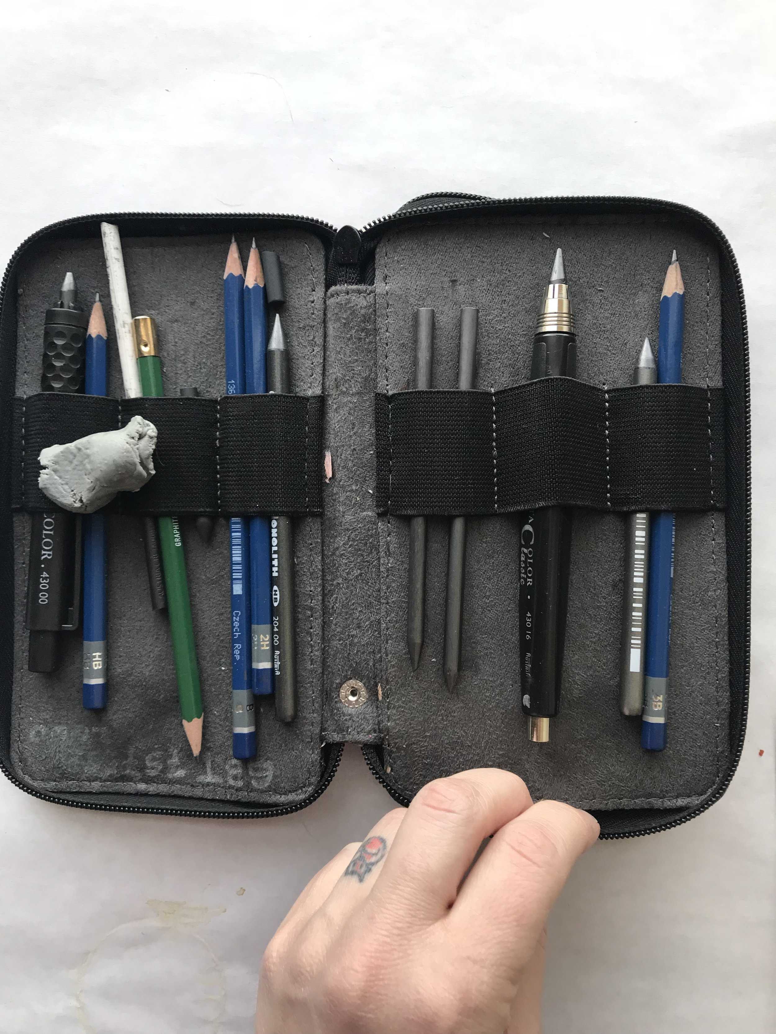 note the eraser and graphite holder tossed in