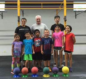 Katie working with the CrossFit Kids/Teens Program