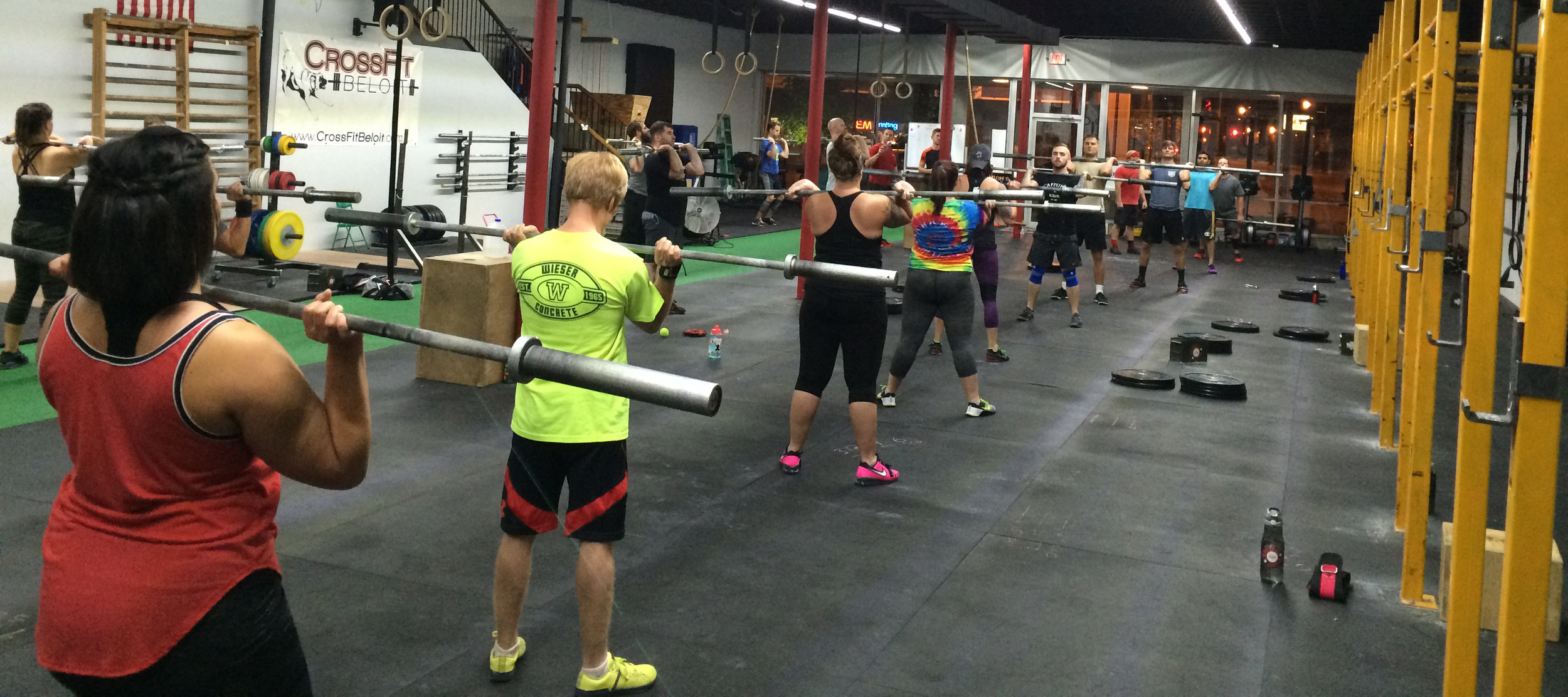 Head Coach and Owner Scott instructing a group CrossFit class