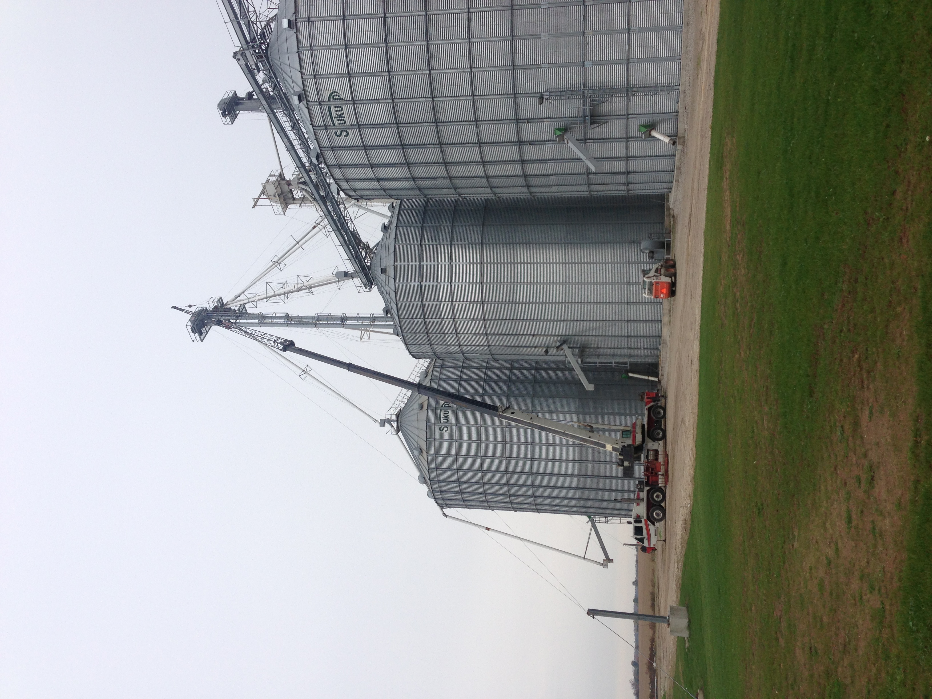 Spout for grain bin being hoisted by 75 ton crane