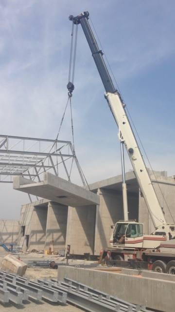 90 ton crane hoisting precast cement