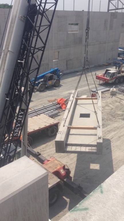 Mobile crane hoisting 60,000 lbs of precast cement
