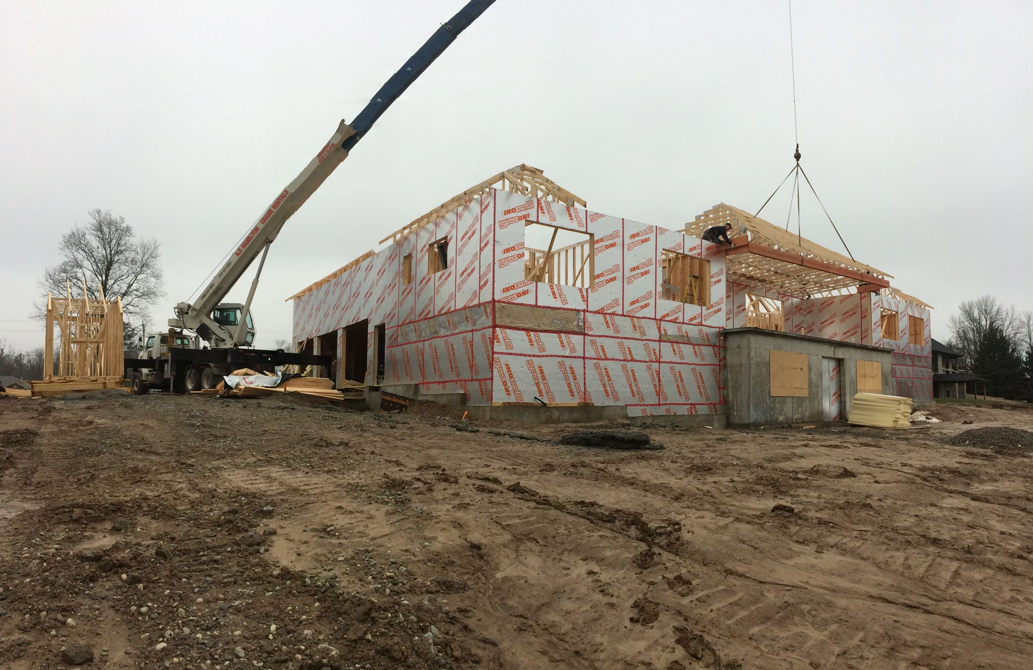 House trusses being held in place by mobile crane
