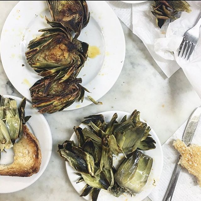 Grilled artichokes, aioli, lemon and bread. It's a very simple yet incredible combination.  If you haven't cooked with whole artichokes before grab some at your local farmers markets and give them a go. I think you'll be pleasantly surprised.  #studioneon #studioneoncatering #artichokes #seasonal
