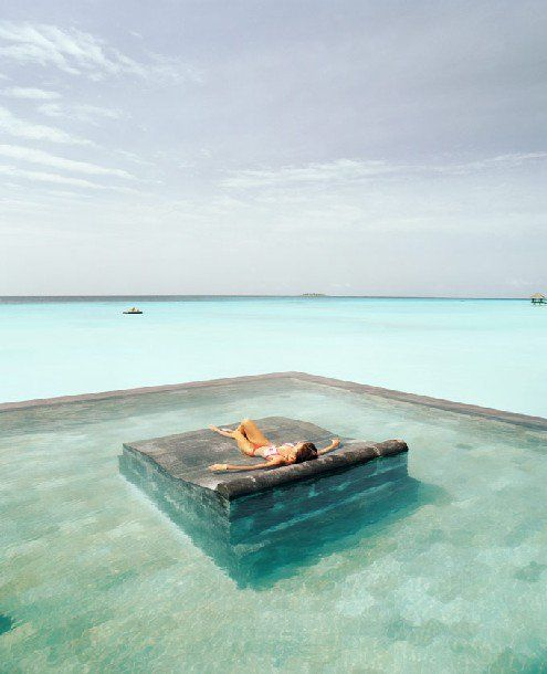 Relax under the sun, or ooh under the stars!  Unknown source VIA  mediacache