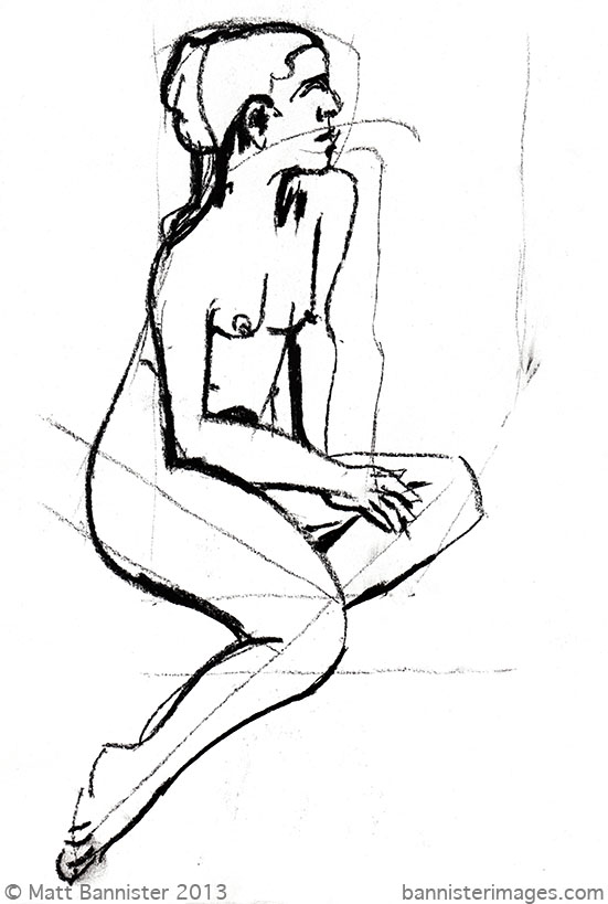 Nude woman seated.
