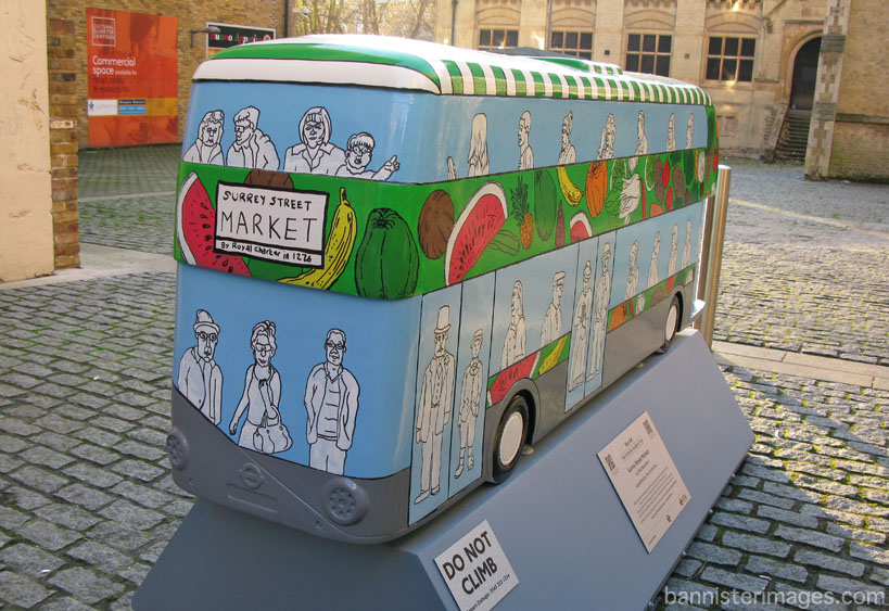 painted sculpture of a London Routemaster bus