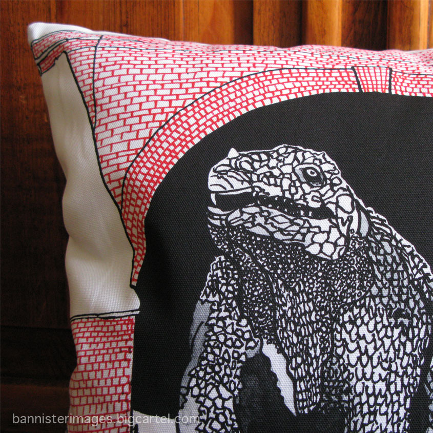 illustrated dinosaur cushion