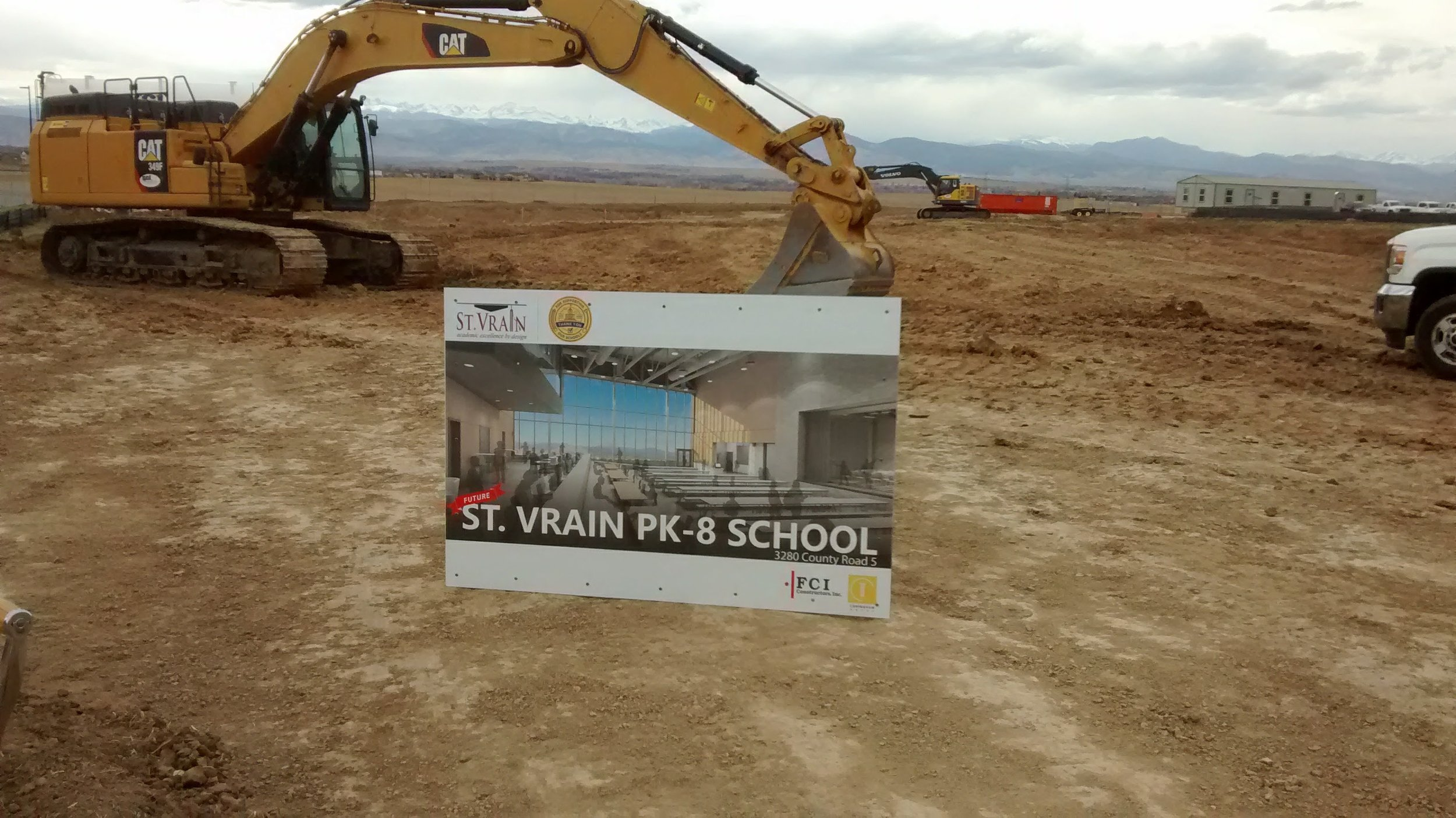 Project sign and excavator