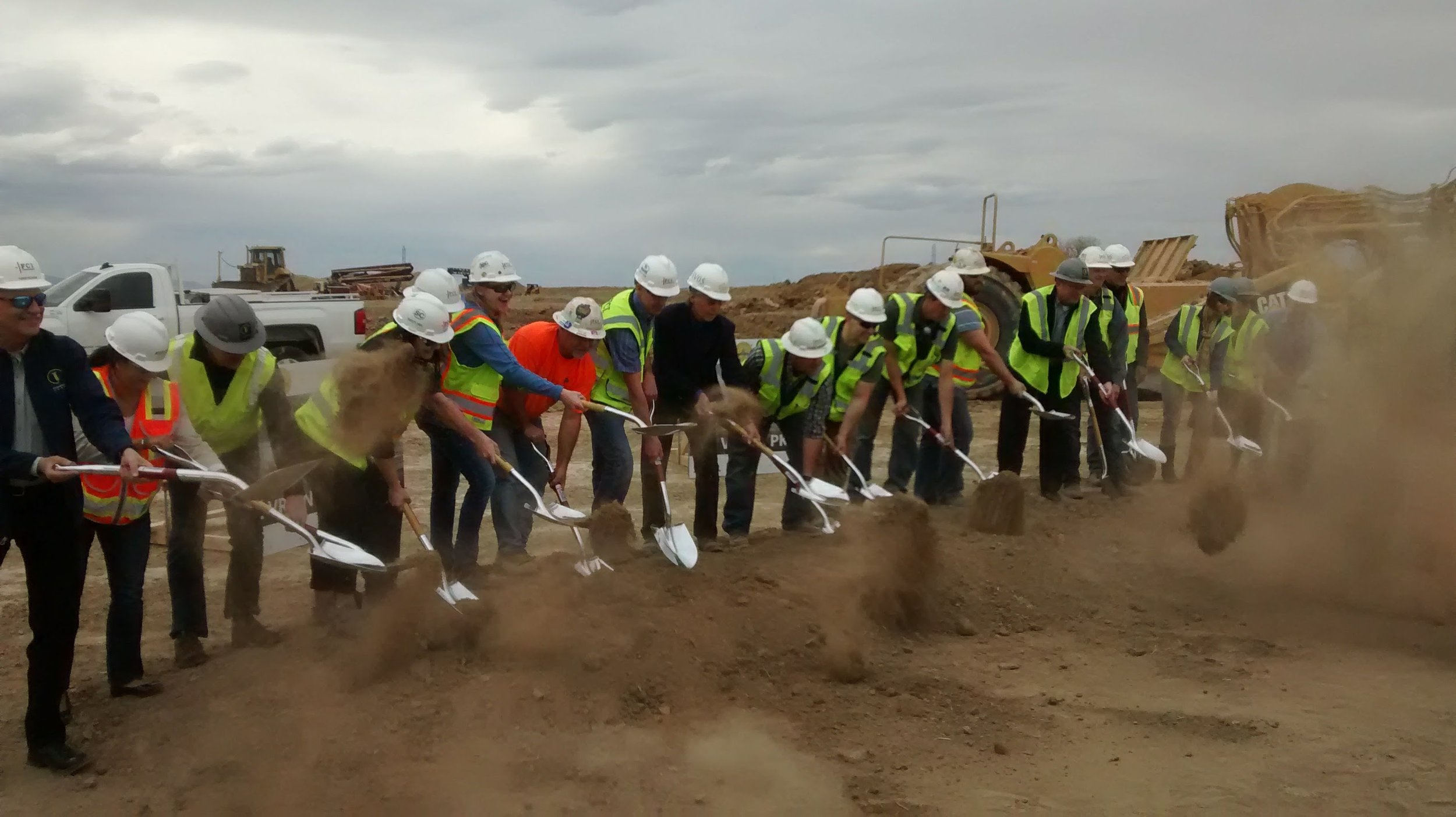 adults breaking ground