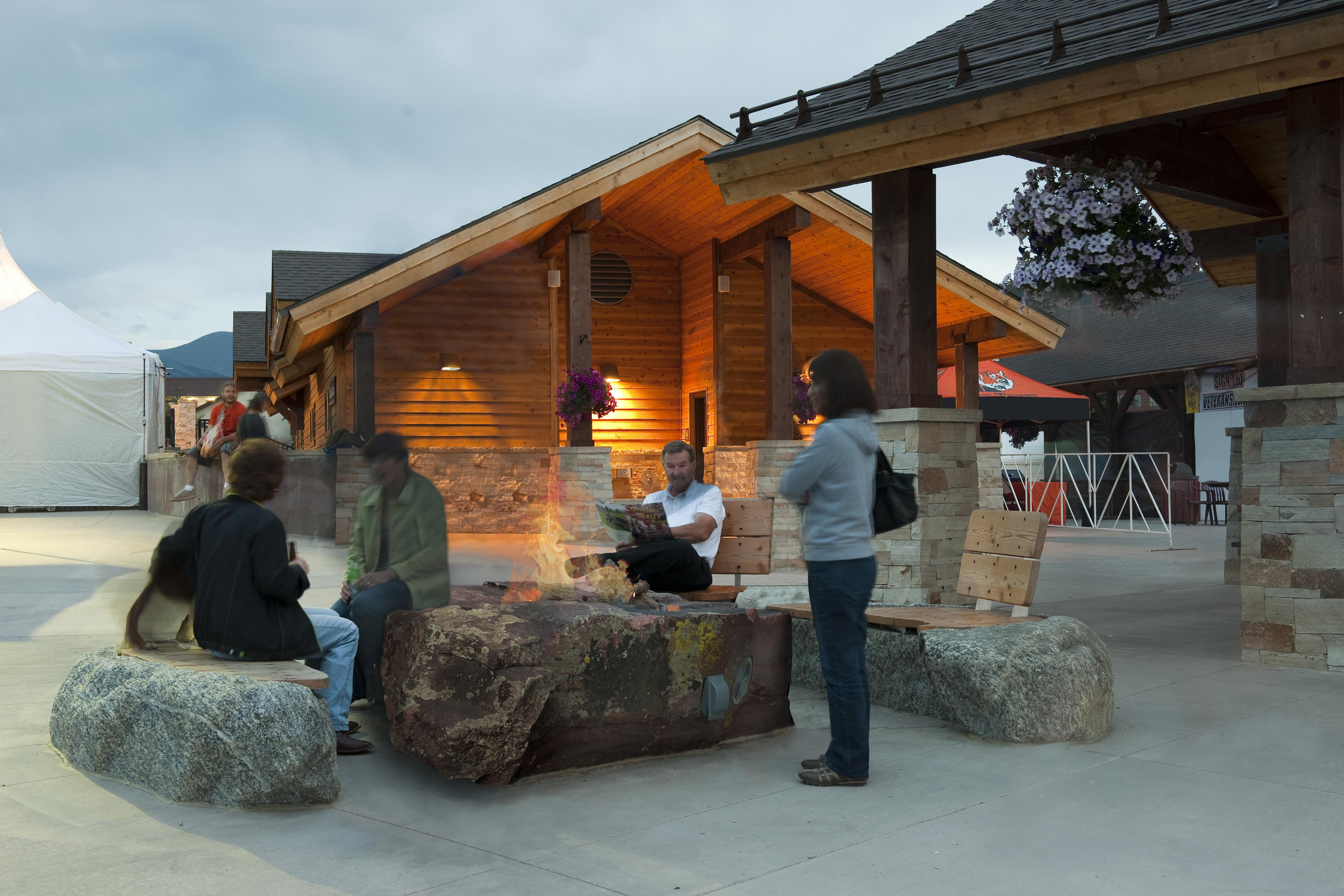 People gather to socialize at the fire pit at Hideaway Park in Colorado amphitheater concert and festival venue and playground
