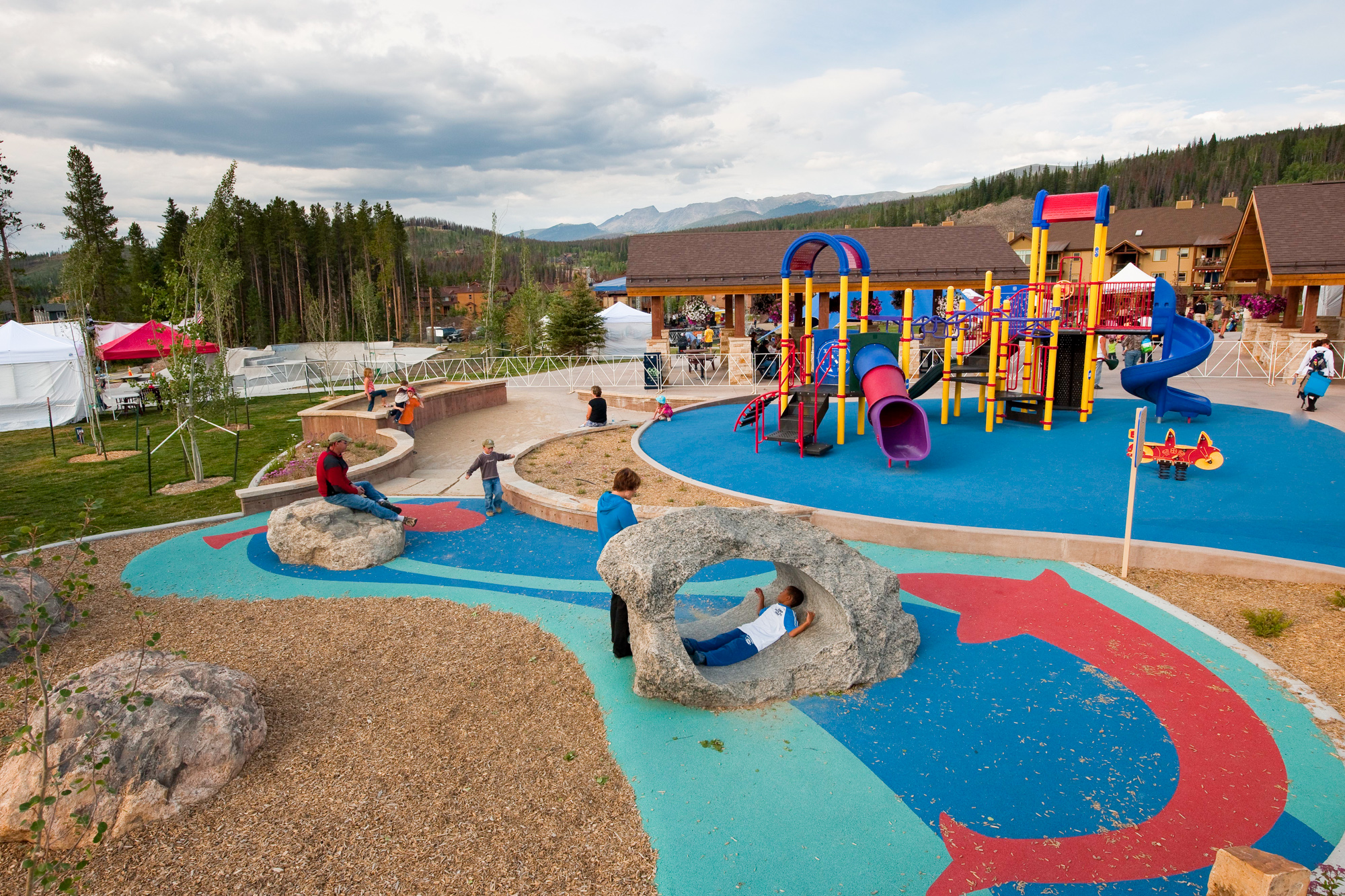 Kids play and explore at Hideaway Park's custom adventure outdoor playground
