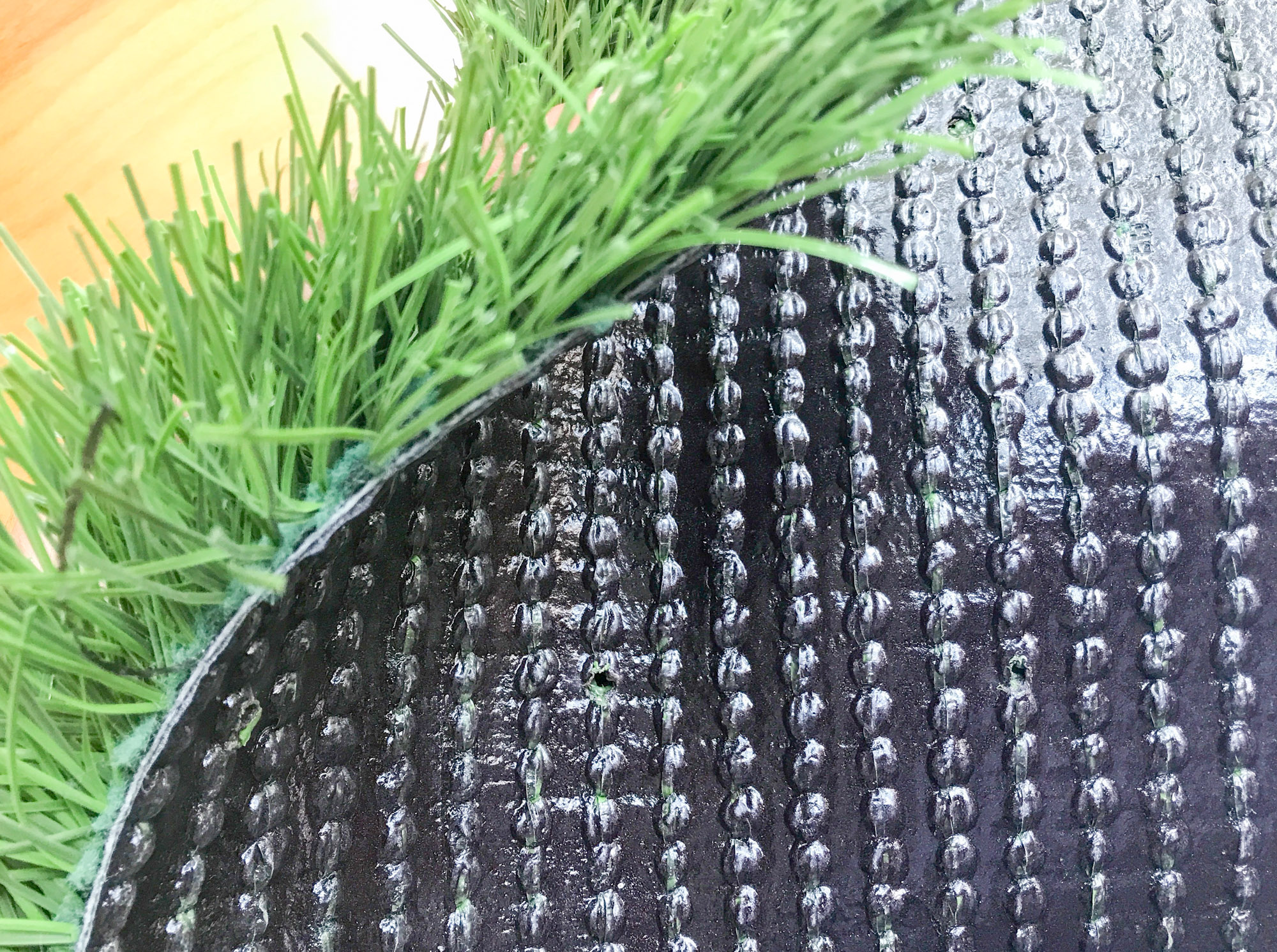 Synthetic turf fibers and backing