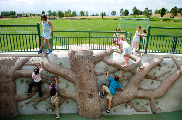 Westlands Park in Greenwood Village Denver Colorado is a destination playground with custom climbing wall, nature play and tree house