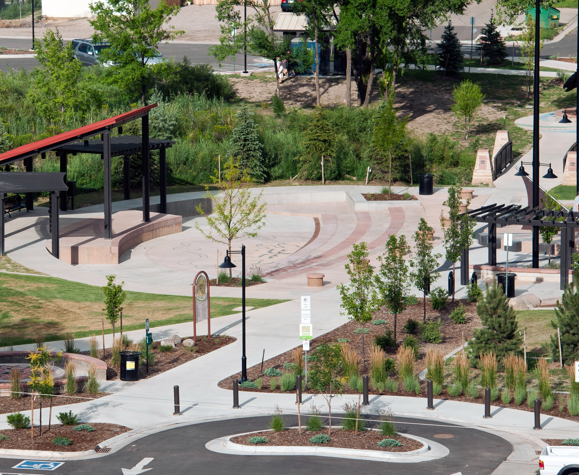 Centennial Park    in Rifle, Colorado, provides walking accessibility throughout the city as well as plenty of ways for residents to get physical activity: playgrounds, a splash pad, bike trails, and nature paths.