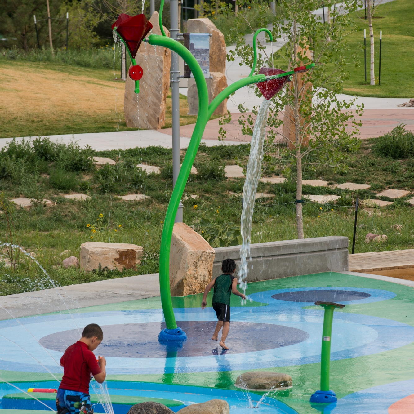 Water dumping on kids at award winning splash pad water play park