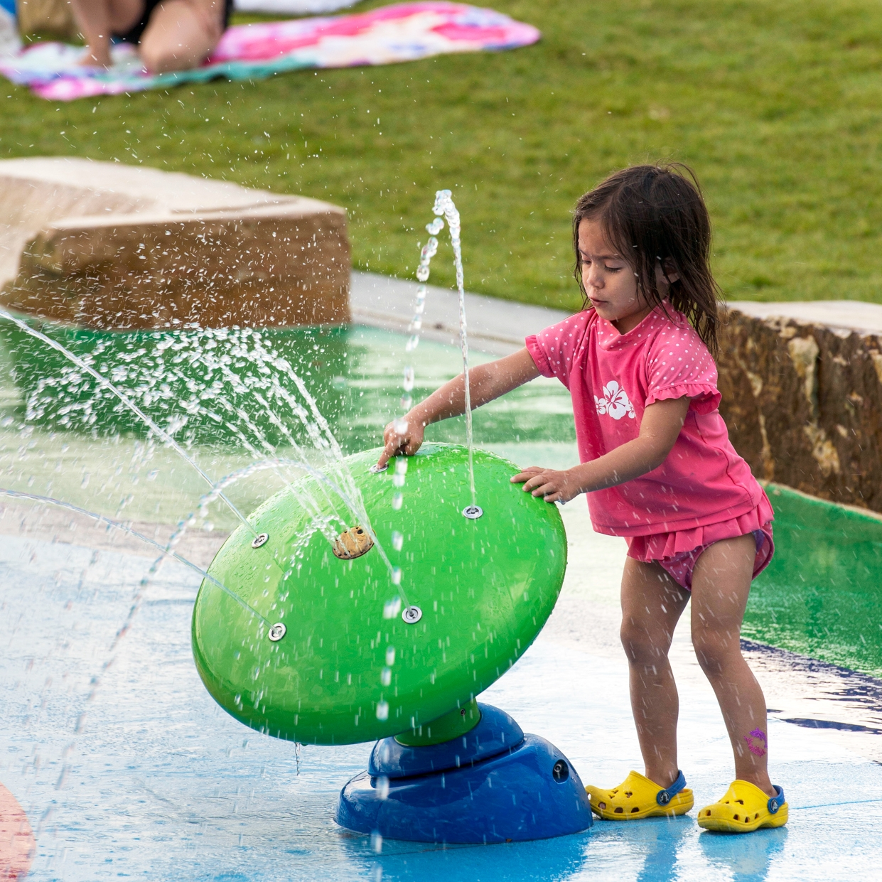 Girl explores a water jet feature