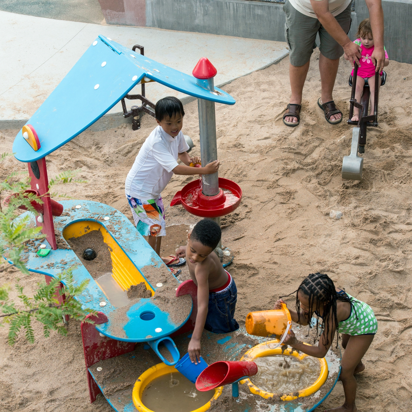 Kids and parents playing in the sand