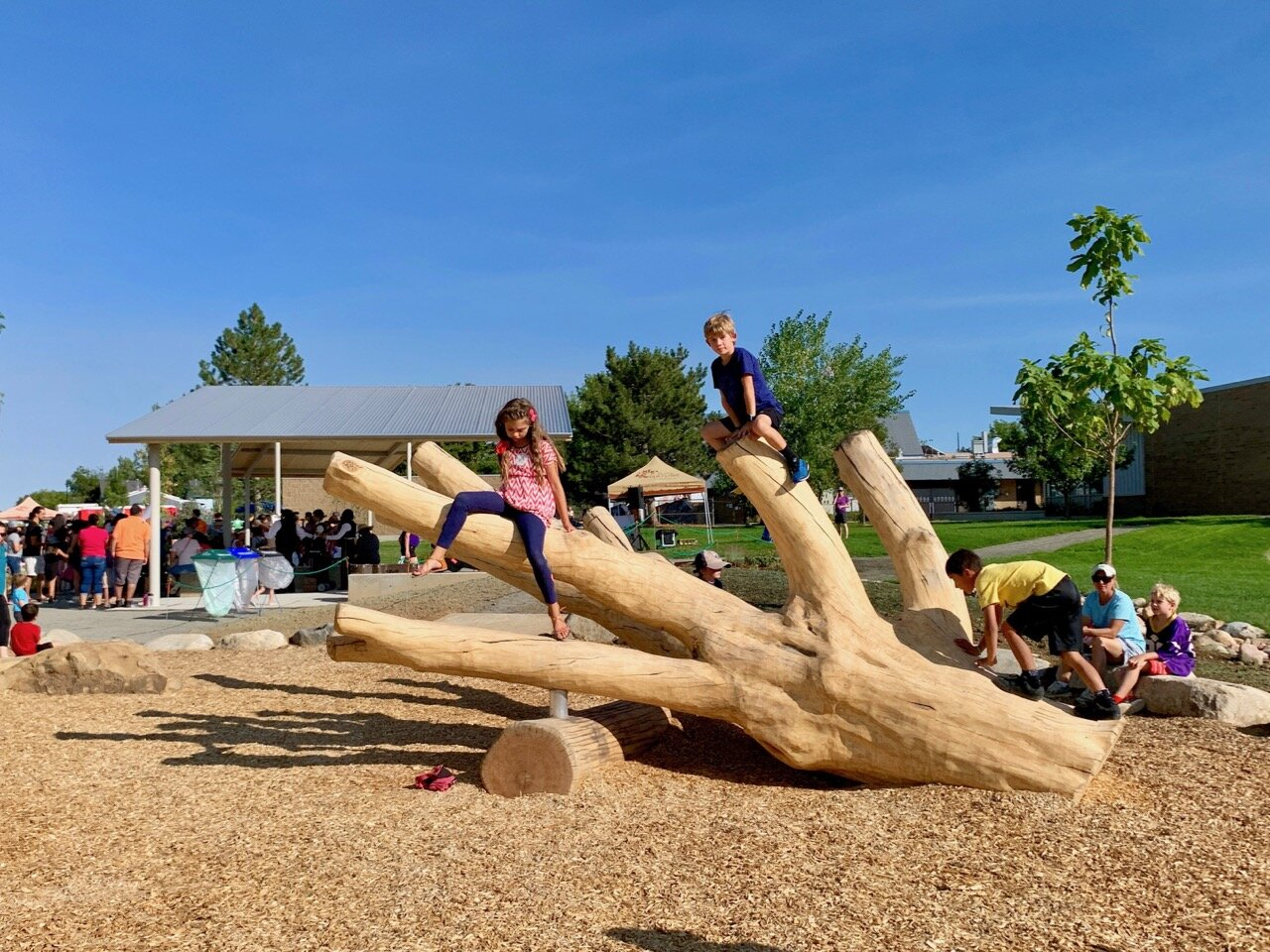 Kids p[aying on tree log at Nature Discovery Area & Inspire Trail in Lafayette, Colorado