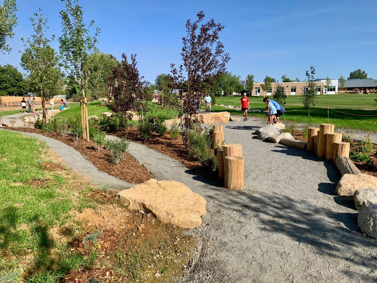 Paths weave through this nature play park and its variety of materials