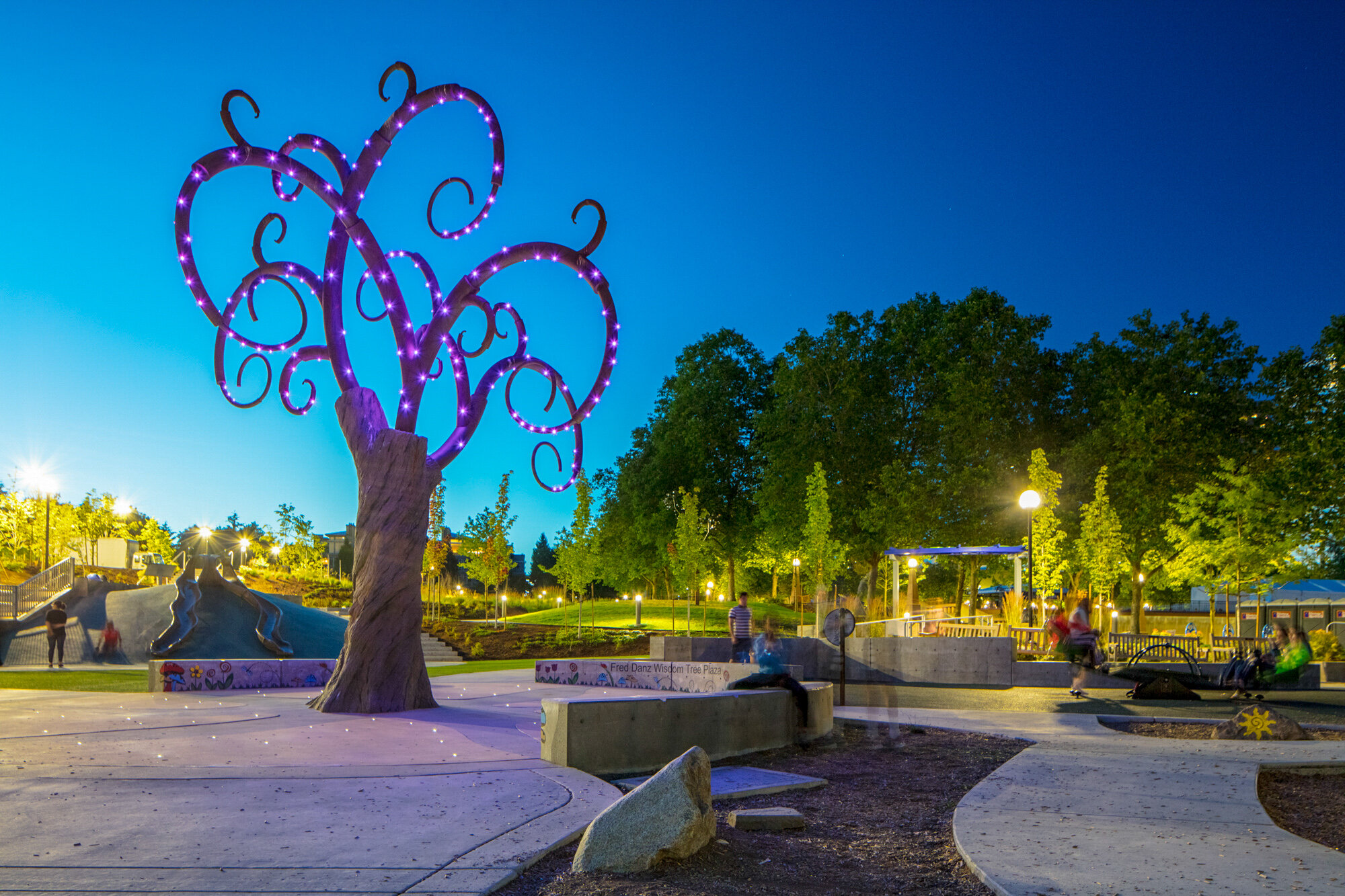 Custom tree sculpture as the central focal point of a plaza at a playground
