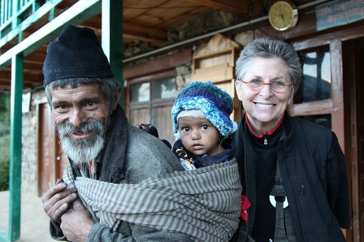 Roshi Joan at her Nomad's Clinic in Humla, Nepal, with a Nepali man and his baby