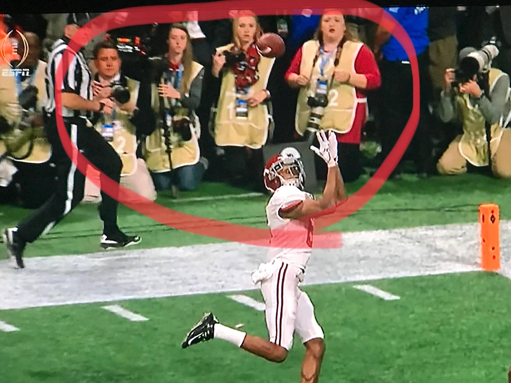 "Photographers ""watching"" the game winning moment. ESPN Screen Grab"