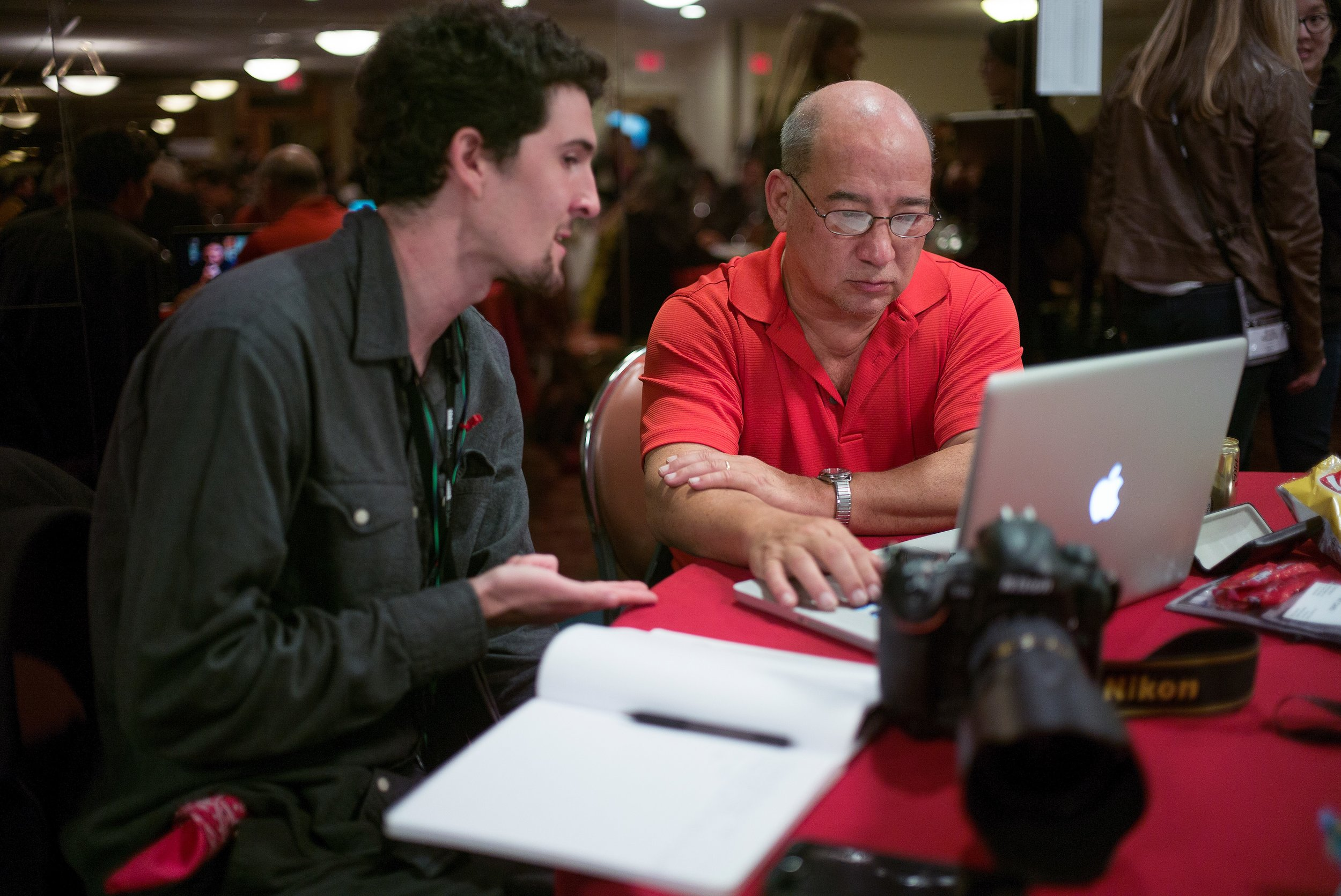 Photo editor Jim Colton (right) during portfolio reviews at the Eddie Adams Workshop. Credit: Robert Caplin