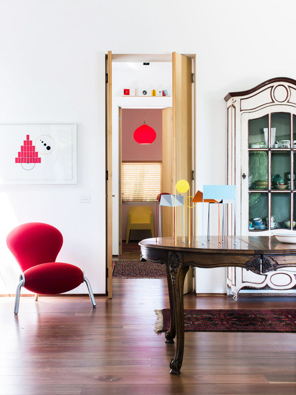 Looking from living area through to study.  Work on paper (left) and small sculptures on table all by Peter D Cole.  Embryo chair by Mark Newson.  French provincial 19th Century painted vitrine. Photo -   Sean Fennessy  , production – Lucy Feagins / The Design Files.