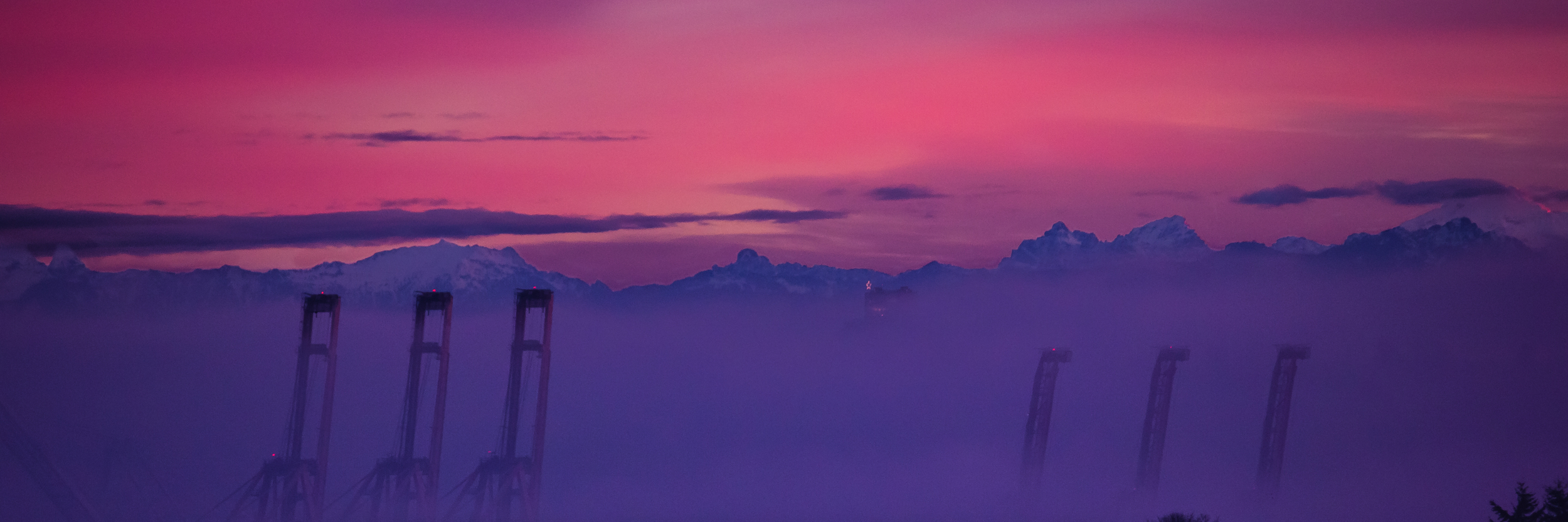 Seattle Cranes and the Cascade Mountains at Sunrise