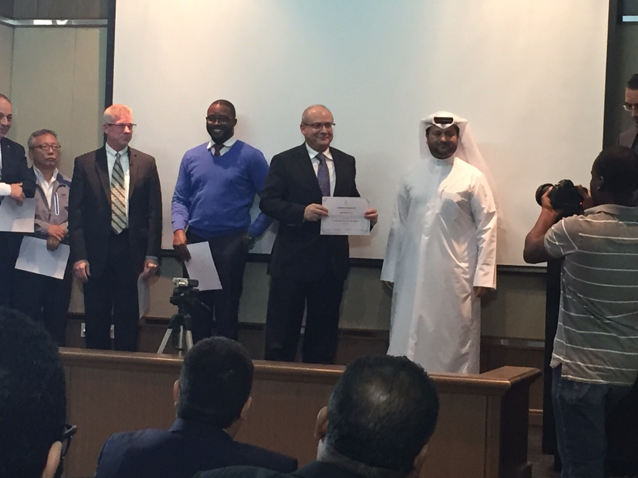 Mr.   Nidal Salameh   accepting Letter of Appreciation