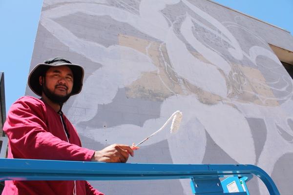 Shah Jackey begins his artwork in Marine Terrace.