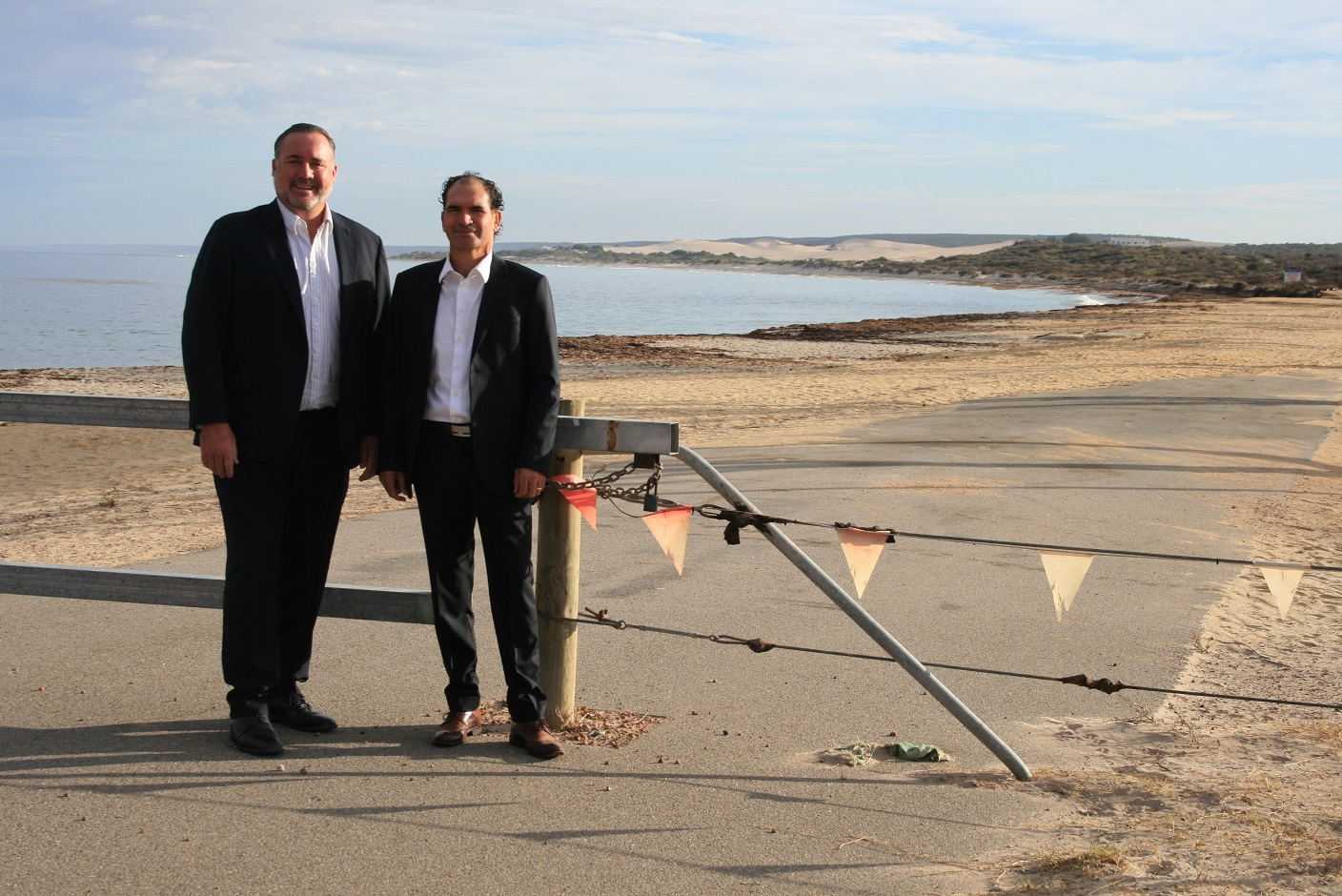 City of Greater Geraldton Mayor Shane Van Styn (left) and Drummond Cove Progress Association President Gavin Hirschhausen at fence around the Whitehill Road Coastal reserve which will be replaced with bollards and rails.