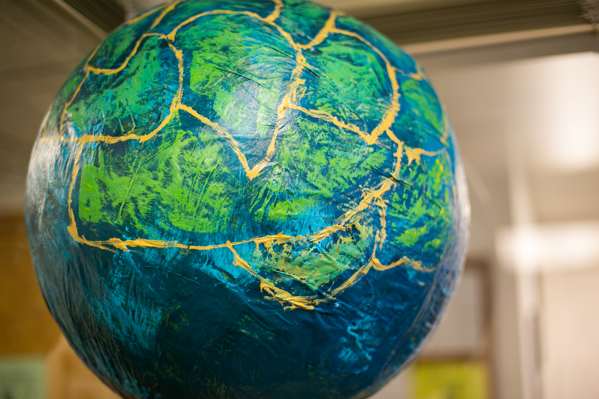 """Pangea"" was the name of the earth's original continent when it was one connected landmass.  For us, ""Pangea"" symbolizes the unity and oneness of our global community.  The pinata-globe depicted above was a gift by one of our board members."