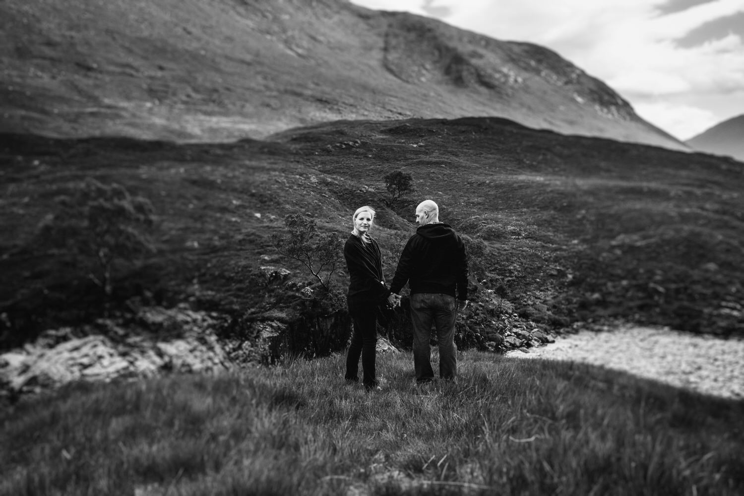Man and woman standing in Glen Etive area of Glencoe