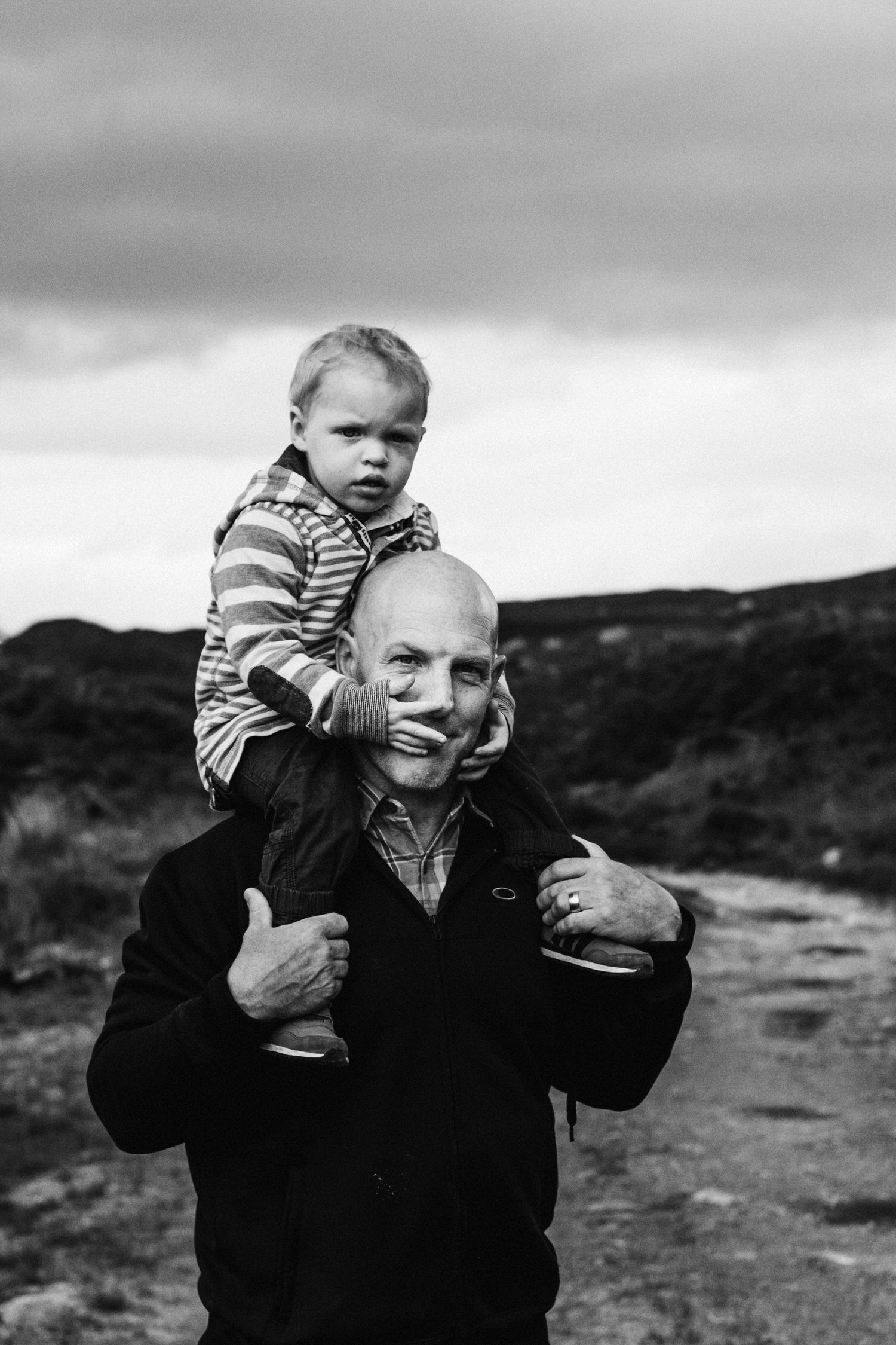 Father with his son on his shoulders, Glencoe