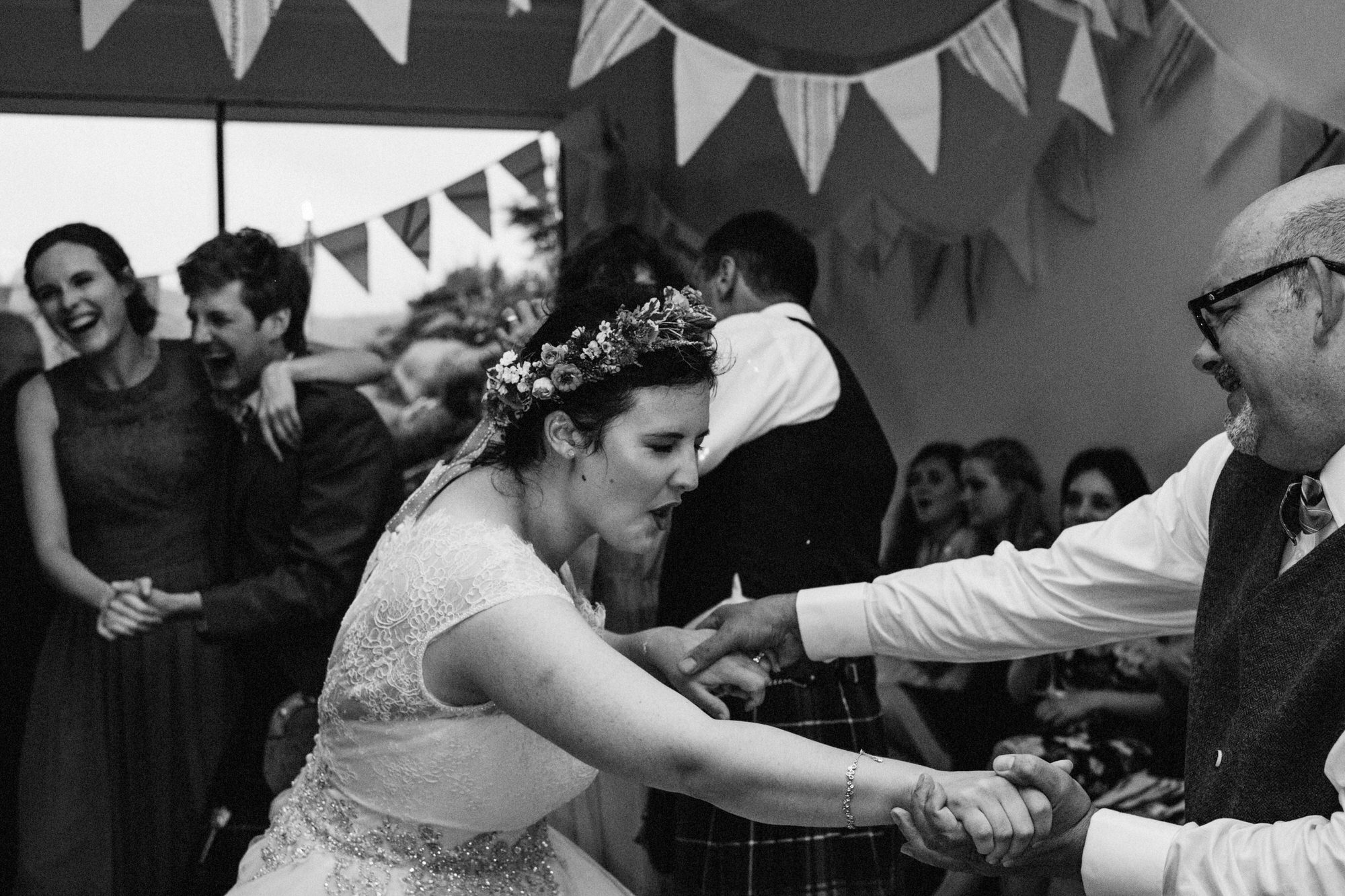 Bride and her father dance energetically