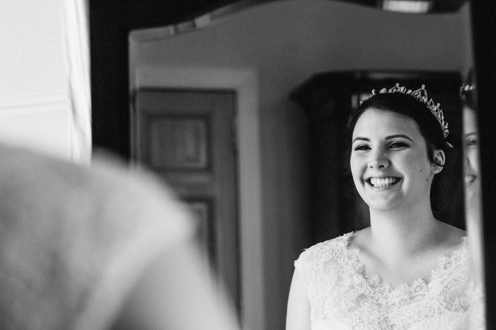 Bride smiling in the mirror