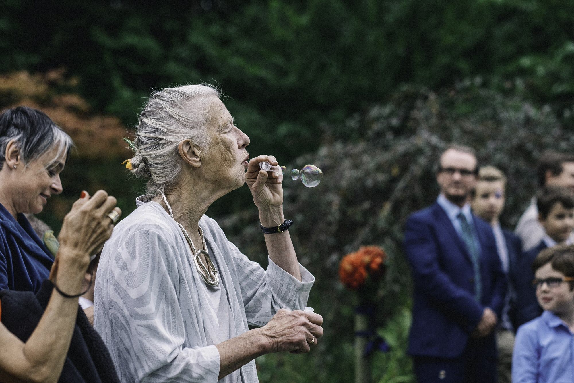 Mother of groom blowing bubbles