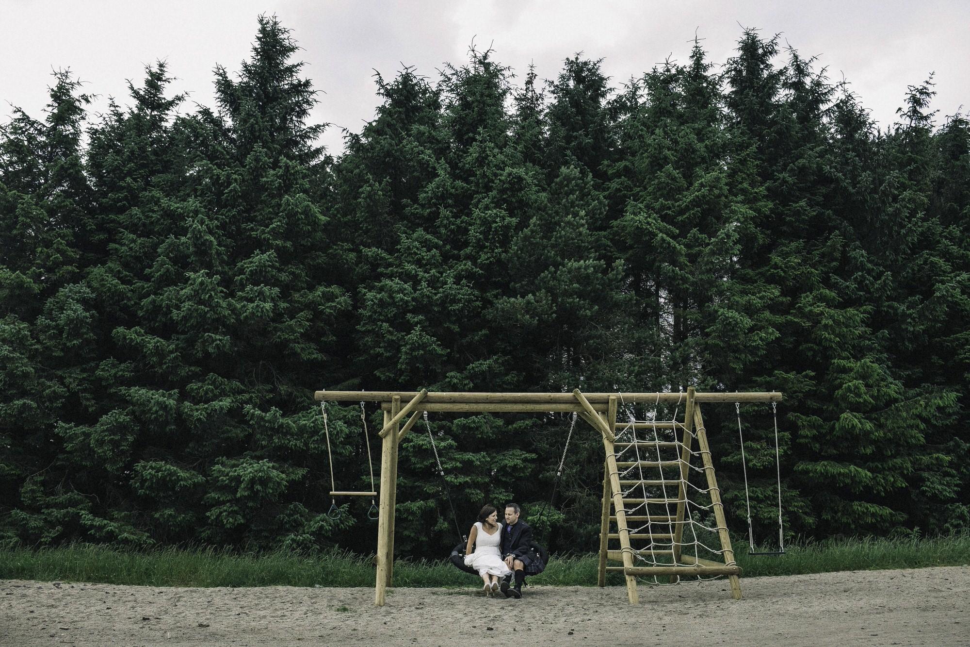 Bride + groom on swing