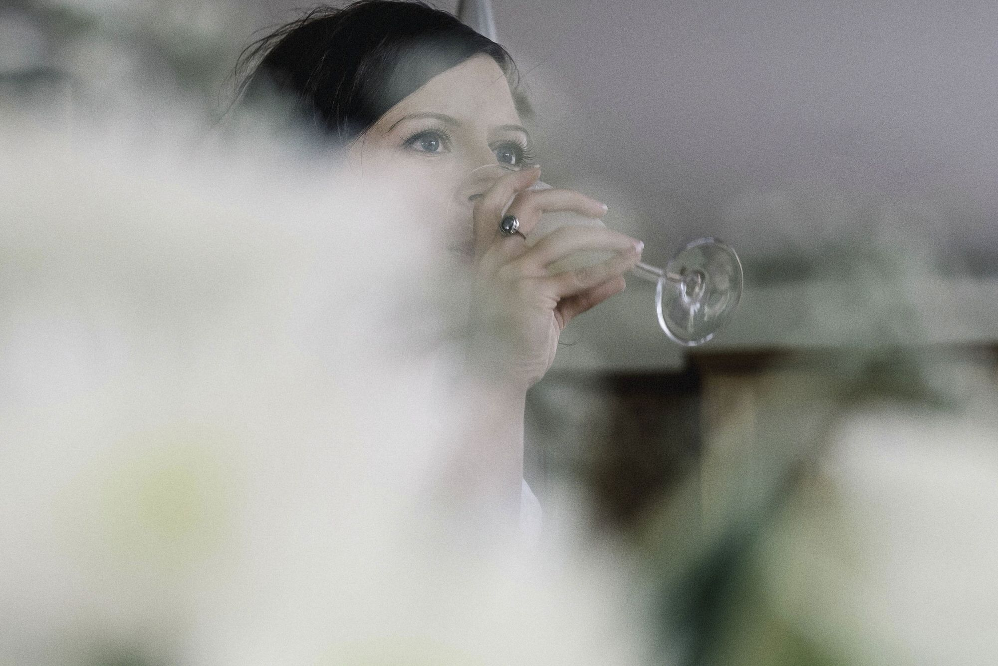 Bride having a drink of Champagne