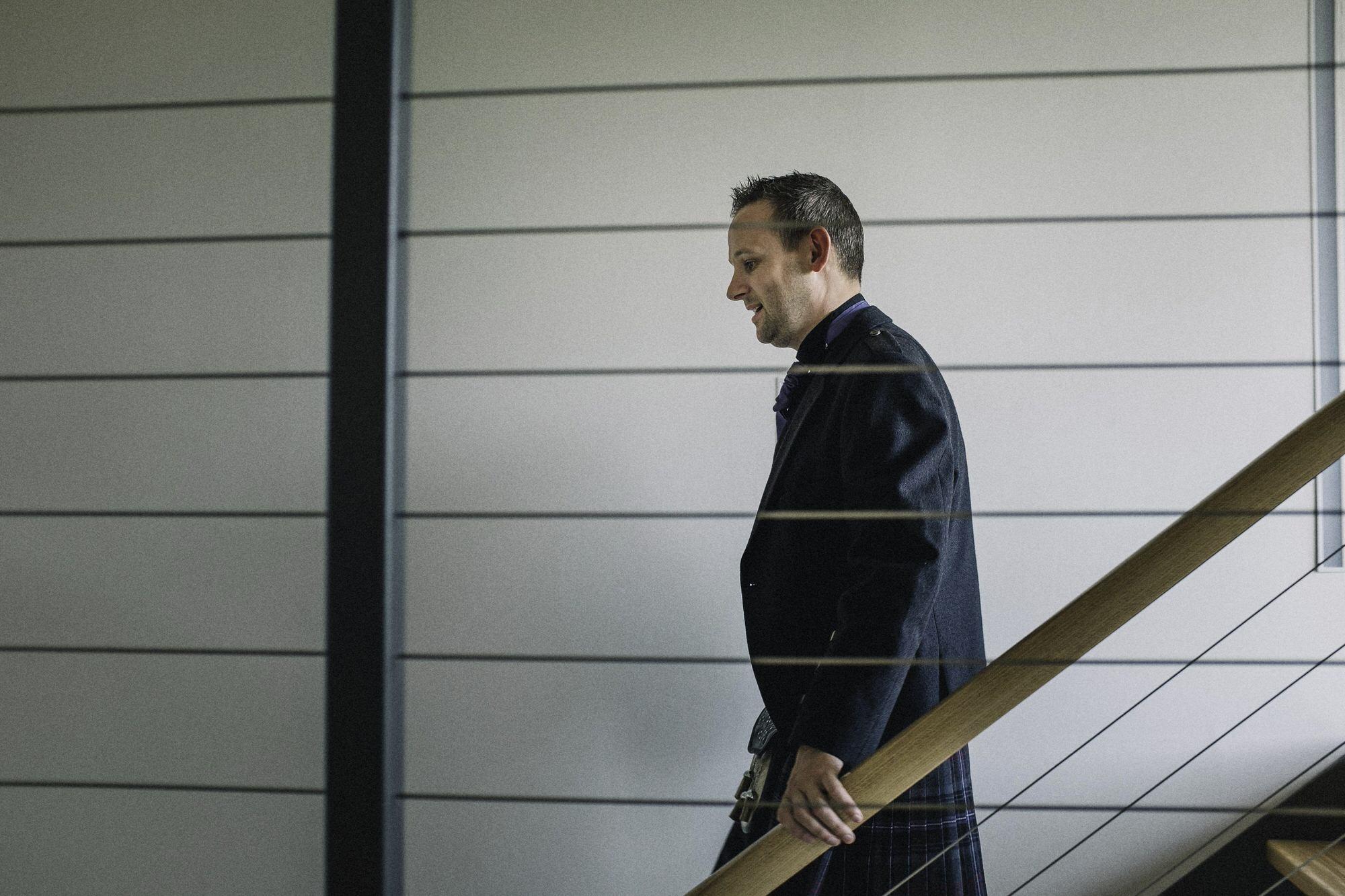Groom walking down the stairs