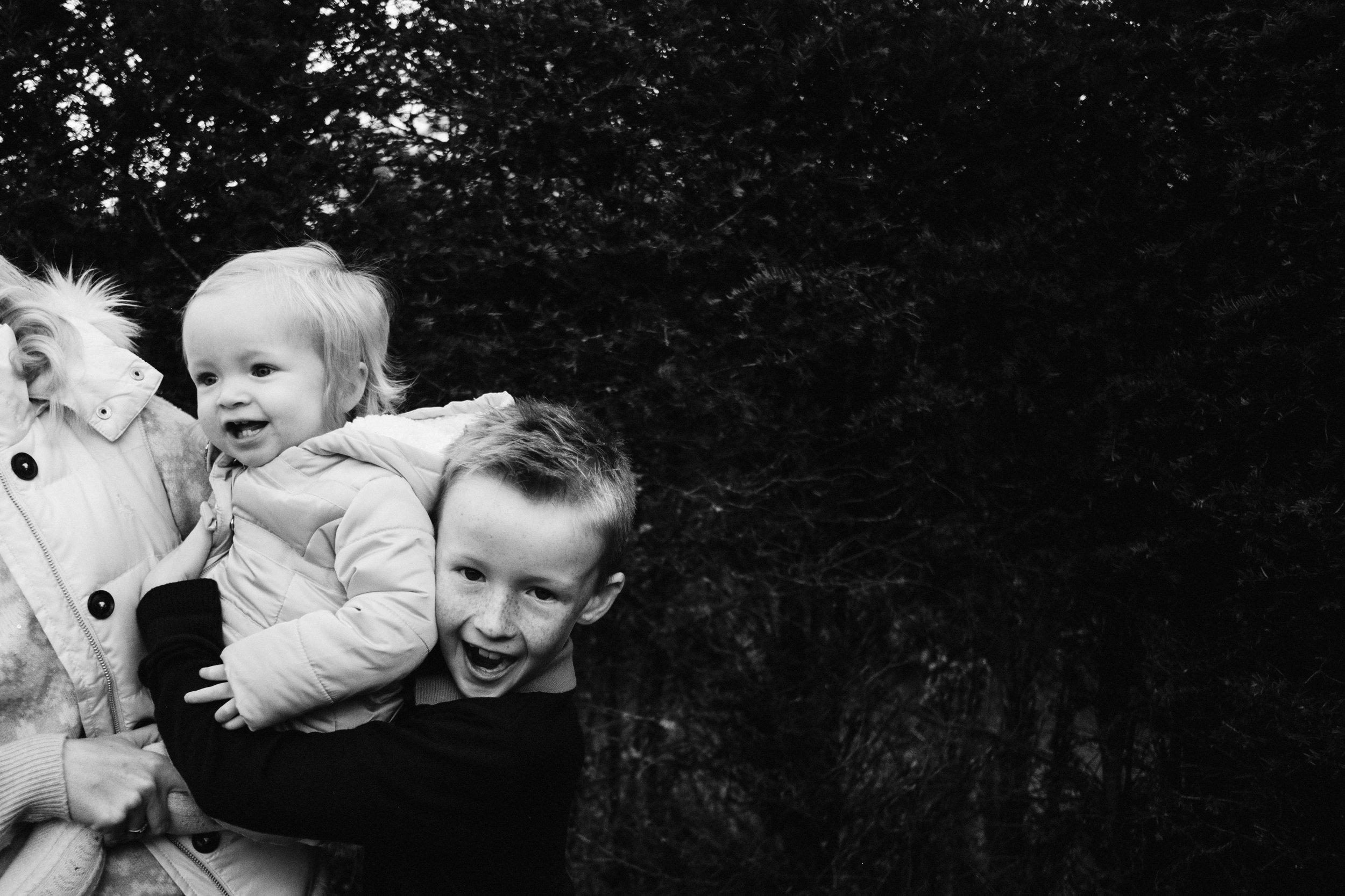 Young boy hugs his sister
