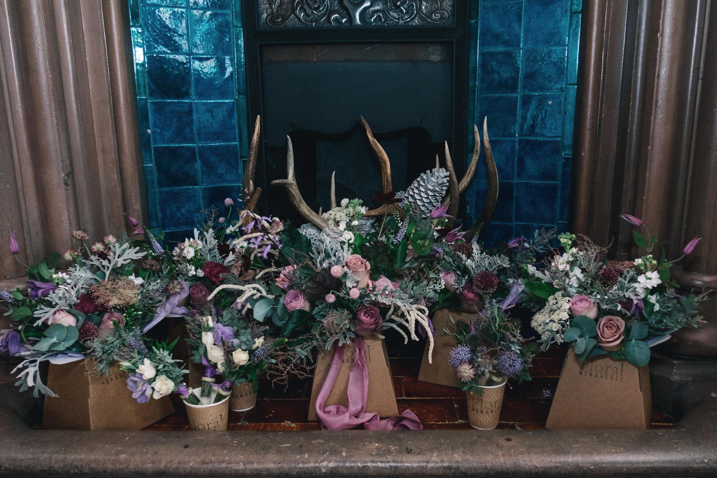 Arrangement of bridal flowers on fire place