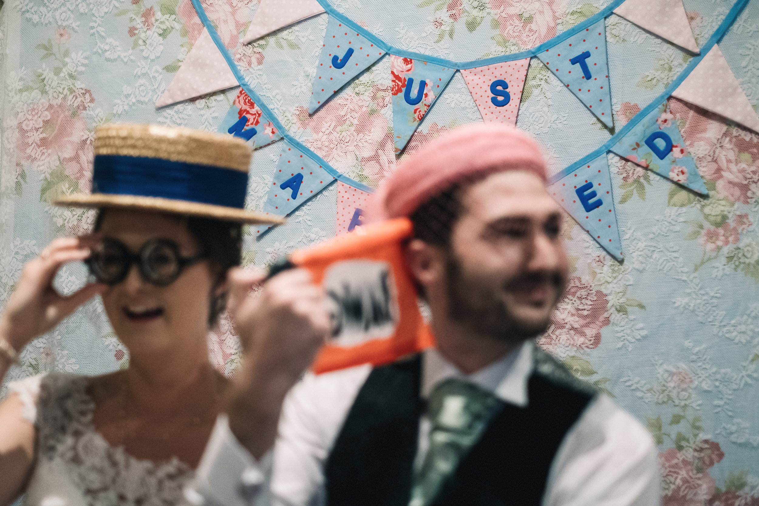 Bride + groom in photo booth
