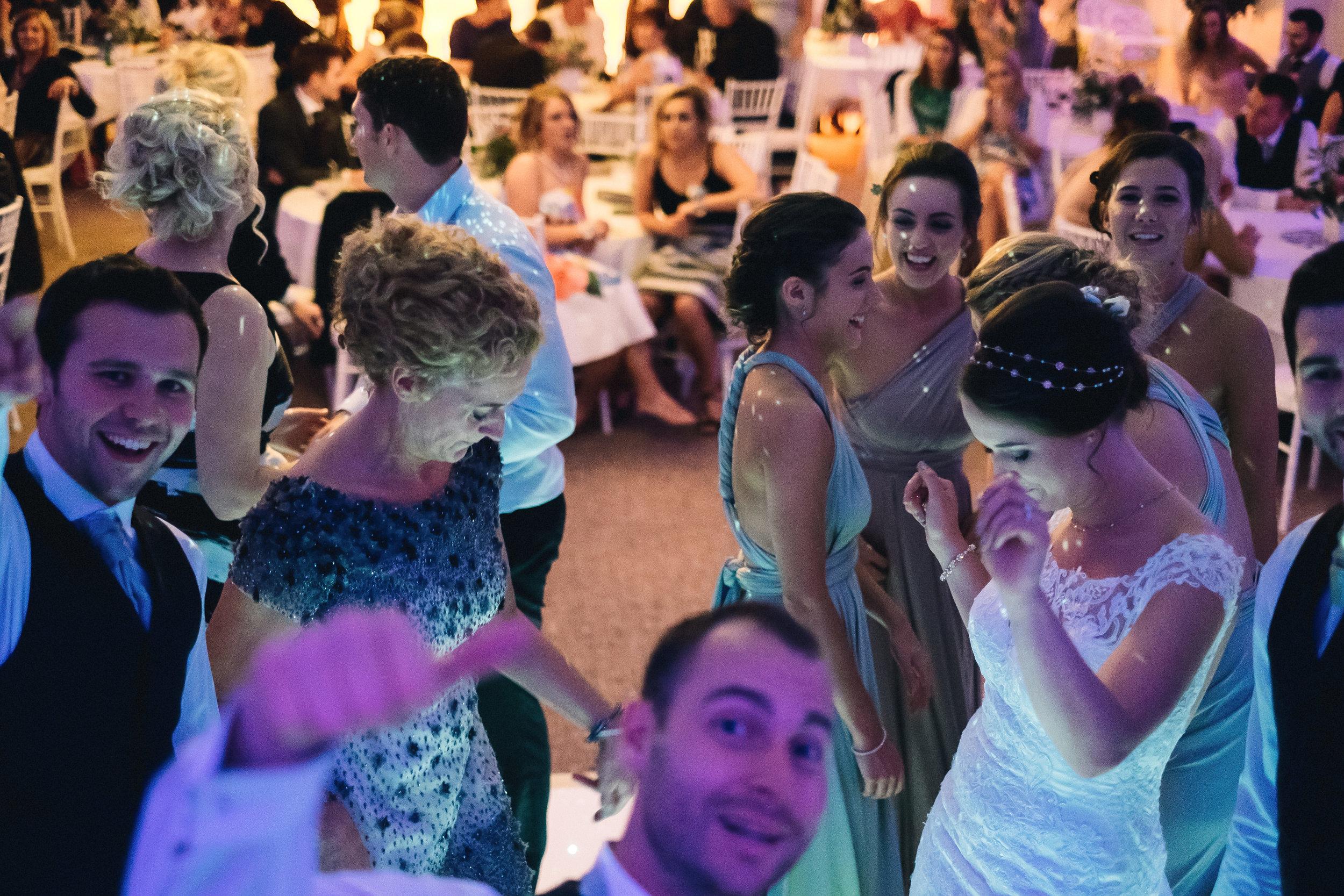 Dancing guests on busy dance floor